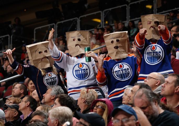Edmonton Oilers fan throws jersey on ice